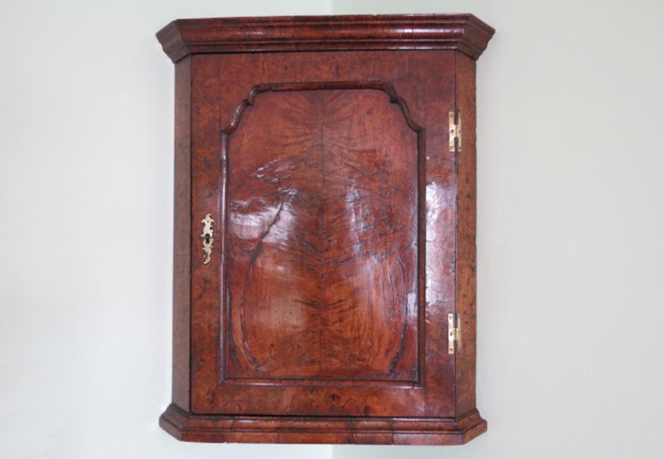 Early 18th century corner cupboard