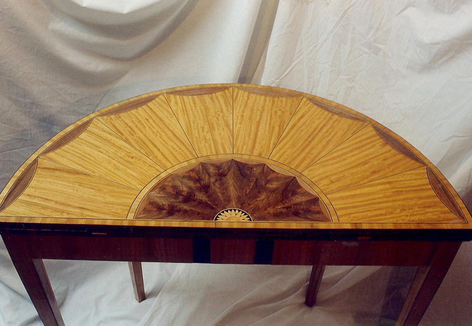 A replica of a satinwood and marquetry tea table, the original found at Kenwood House.