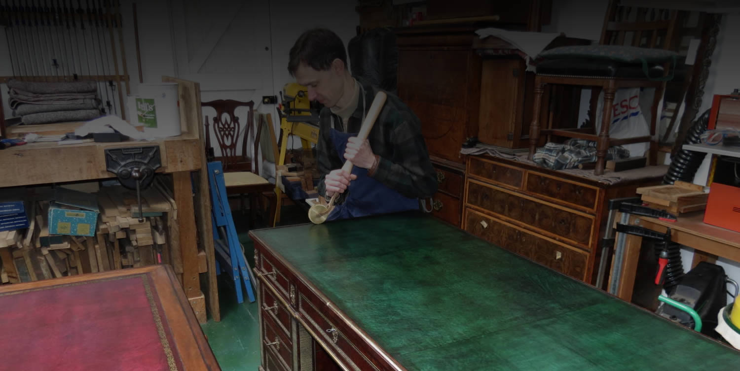 Repair of desk leather