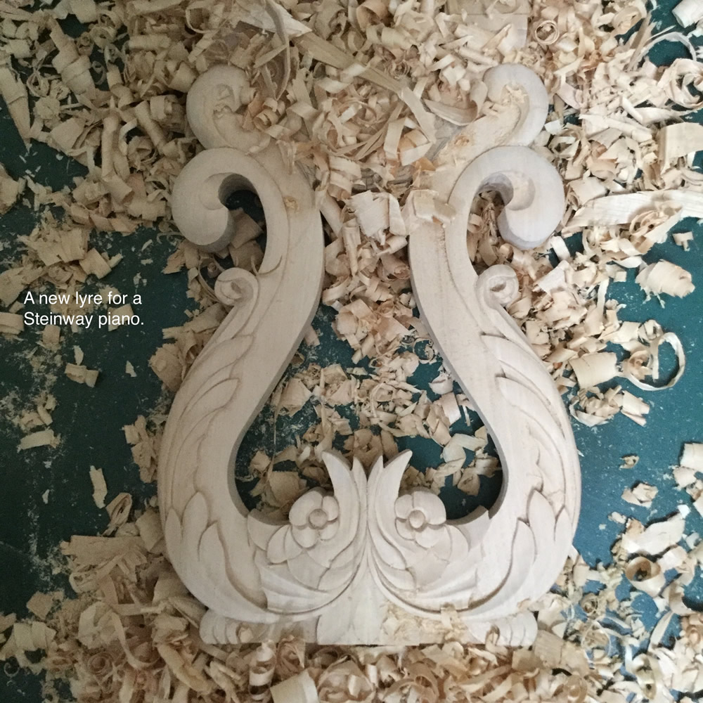 A newly carved lyre for a Steinway Piano