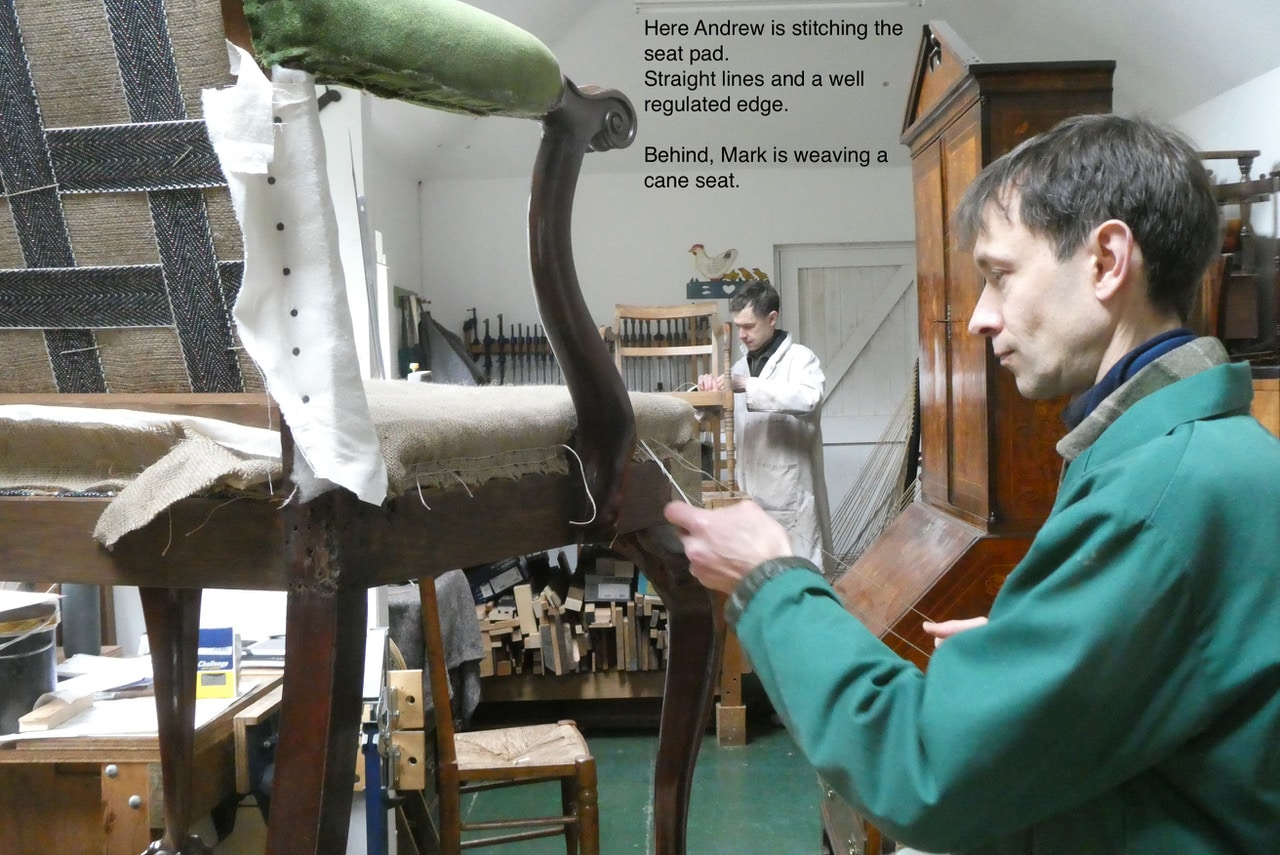 Here Andrew is stitching the seat pad. Straight lines and a well regulated edge. Behind, Mark is weaving a cane seat.